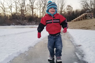 Smiling boy on ice | coyotehill.org