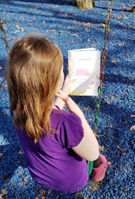 child outside reading | coyotehill.org