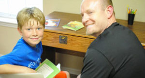 reading with volunteer | coyotehill.org
