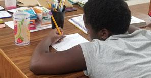 child doing homework | coyotehill.org
