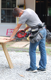 summer employee sawing | coyotehill.org