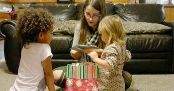 mom helps girls open gifts | coyotehill.org