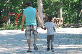 father and foster son hold hands | coyotehill.org