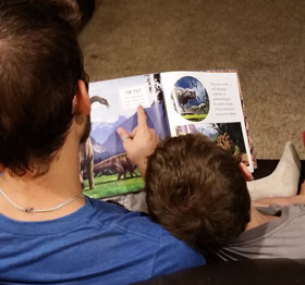 foster dad and boy read together | coyotehill.org