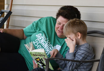 Volunteer reading with child | coyotehill.org