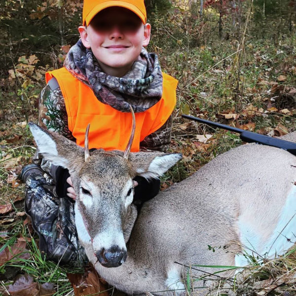 boy with his first deer | coyotehill.org