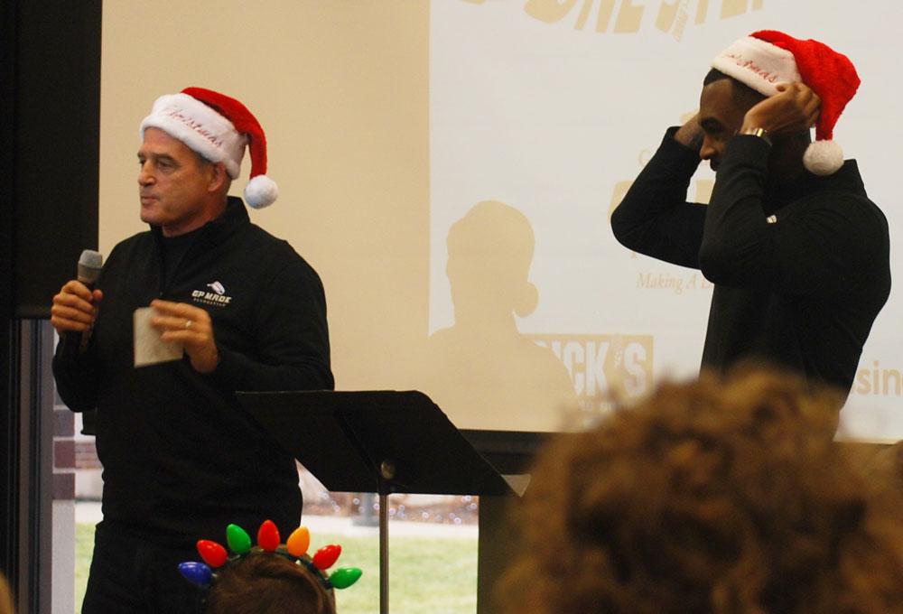 Coach Gary Pinkel and L'Damian Washington with Santa hats | coyotehill.org