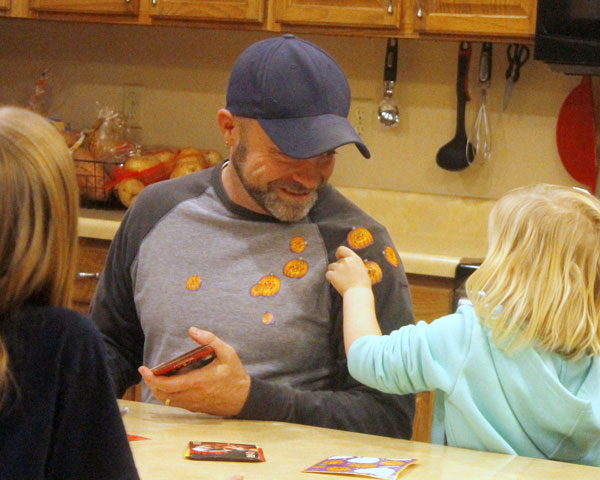 foster daughter places stickers on dad | coyotehill.org
