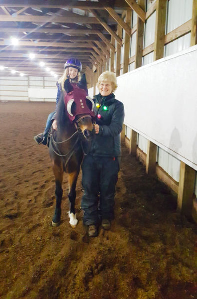 Girl rides in Overton Arena with help from volunteer | coyotehill.org
