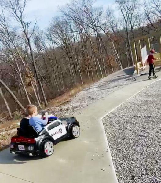 boys in police car | coyotehill.org