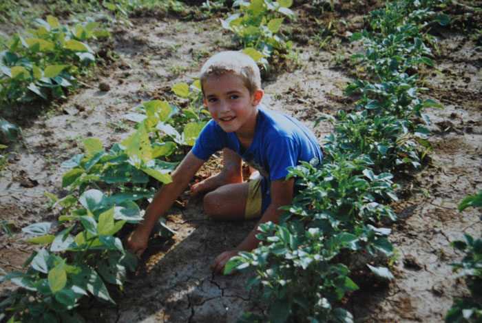 boy gardens at Coyote Hill in 1993 | coyotehill.org