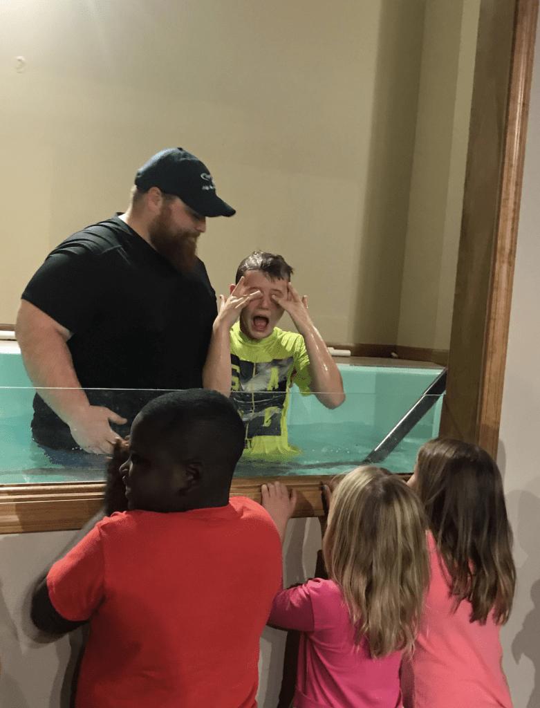 Home Parent Dad baptizes boy at Harrisburg Christian Church   coyotehill.org