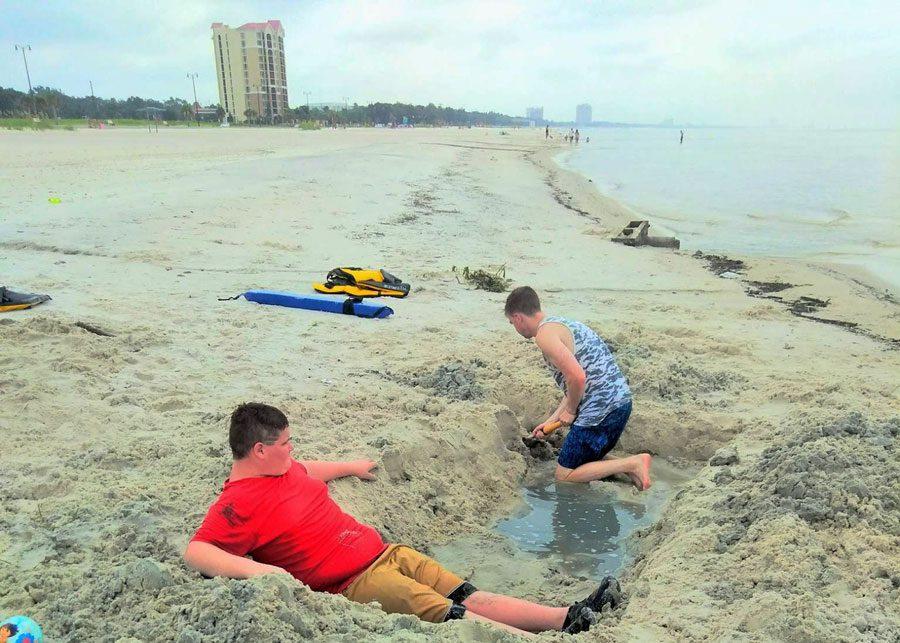 Boys enjoy being boys at the beach in Gulfport | coyotehill.org
